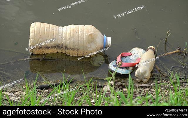 Rubbish plastic bottle and container at the river
