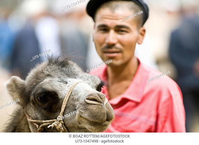 Selling his camel in the colorful Sunday market of Kashgar