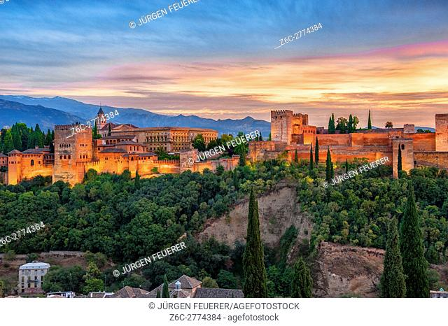 The palace of Alhambra at sunset with the mountains of Sierra Nevada, Granada, Andalusia, Spain