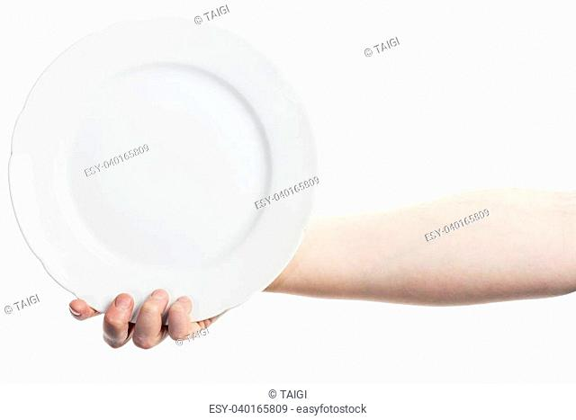 Female hand holding big white plate isolated on white background