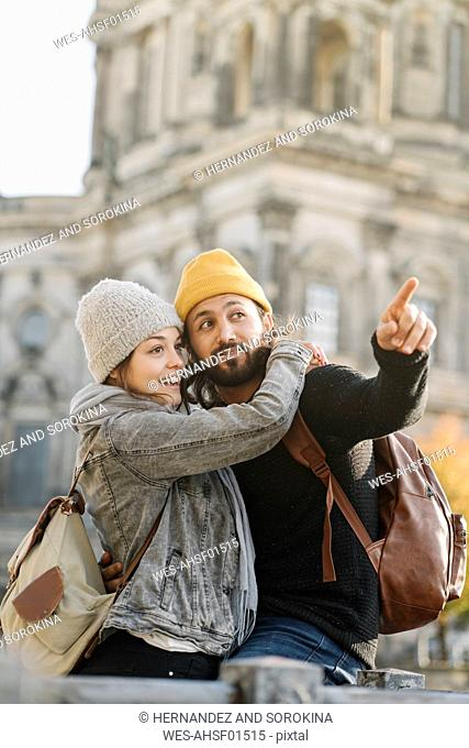 Happy young couple in the city with Berlin Cathedral in background, Berlin, Germany