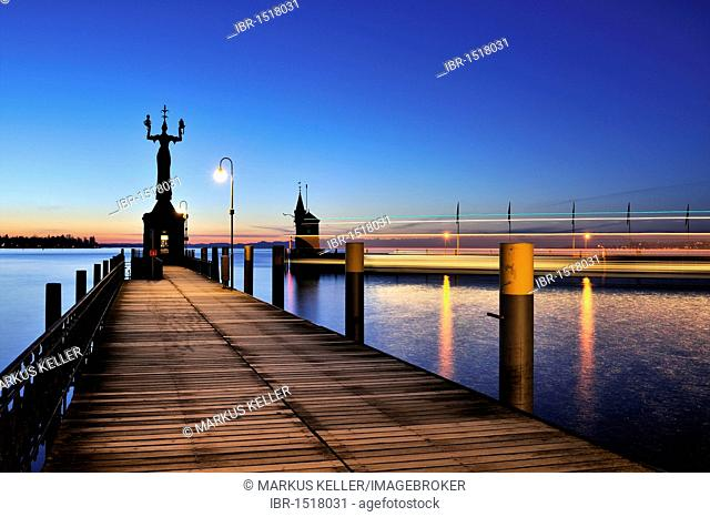 The harbor pier at Constance harbor port entrance just before dawn, tide gauge with the Imperia Statue on it, the town's landmark, district of Konstanz