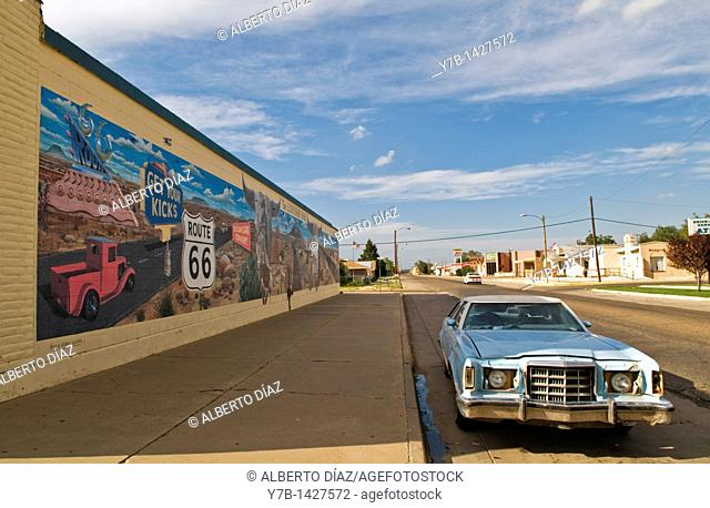 Abandoned car beside a graffiti in Tucumcari, New Mexico, on route 66