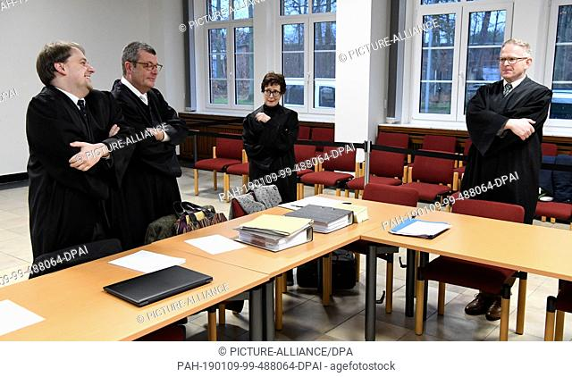 09 January 2019, Schleswig-Holstein, Lübeck: Representatives of the joint plaintiffs are waiting in the courtroom for the start of the trial in the security...