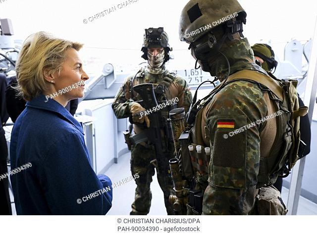 The German defence minister Ursula von der Leyen on the deck of the Alster, a German navy corvette, with frogmen belonging to the Standing Maritime Unit 1 in...