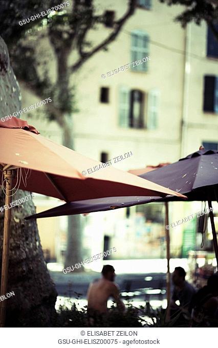 Blurred Men Under Umbrellas, Lorgues, France
