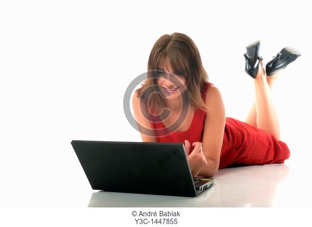 Woman with laptop computer on white floor