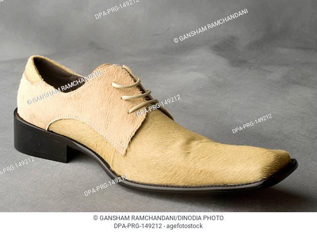 Skin color leather shoe on gray background MR