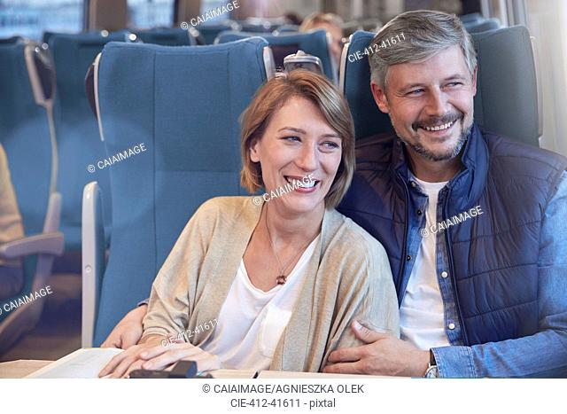Happy couple on passenger train