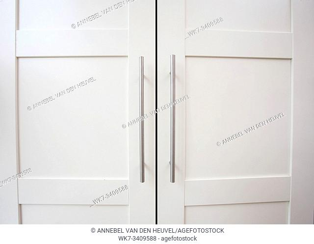 White closet doors wood closeup background texture modern design clean