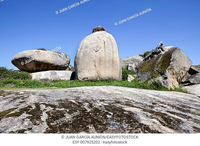 Storks nest in the Barruecos Natural Park, Caceres, Spain. This is a spectacular natural creation with enormous granite boulders