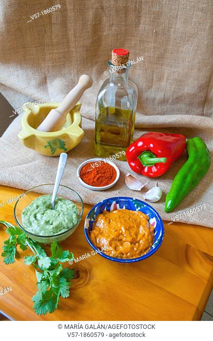 Mojo verde and mojo rojo sauces with ingredients. Canary Islands, Spain