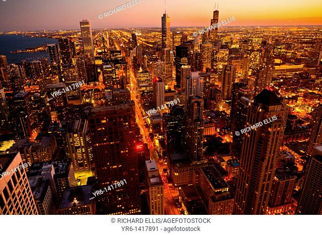 Sunset over the Chicago skyline looking south from the Hancock Tower along the lake front in Chicago, IL, USA