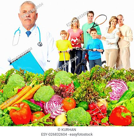Doctor with vegetables and family. Healthy diet and nutrition