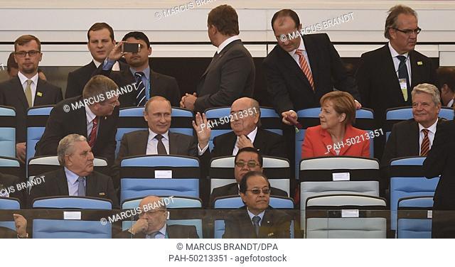 IOC President Thomas Bach (L-R), Russia's President Vladimir Putin, FIFA President Sepp Blatter, Germany's Chancellor Angela Merkel and German President Joachim...