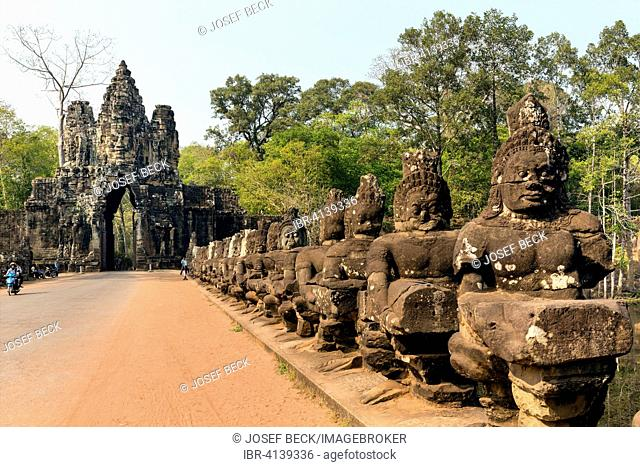 South Gate of Angkor Thom, Avalokiteshvara face tower, Asura statues, Gopuram, demons balustrade on the bridge, Angkor Thom, Siem Reap, Cambodia