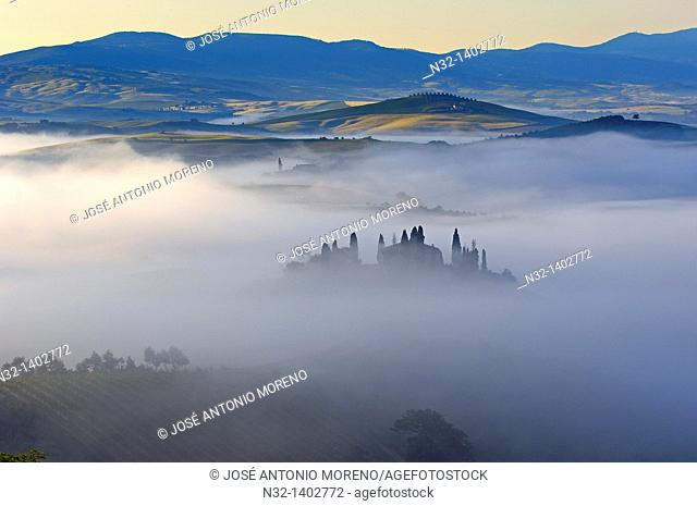 Val d'Orcia  Orcia Valley  Morning fog  The Belvedere at dawn UNESCO World Heritage Site  San Quirico d'Orcia  Siena Province  Tuscany  Tuscany landscape  Italy...