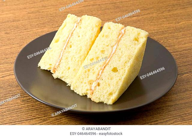 Snack and Dessert, Vanilla Chiffon Cake Made With Butter, Eggs, Sugar, Flour, Baking Powder and Flavorings on White Dish