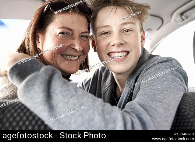 Teen boy with his mother in car, in Gaissach, Bavaria, Germany