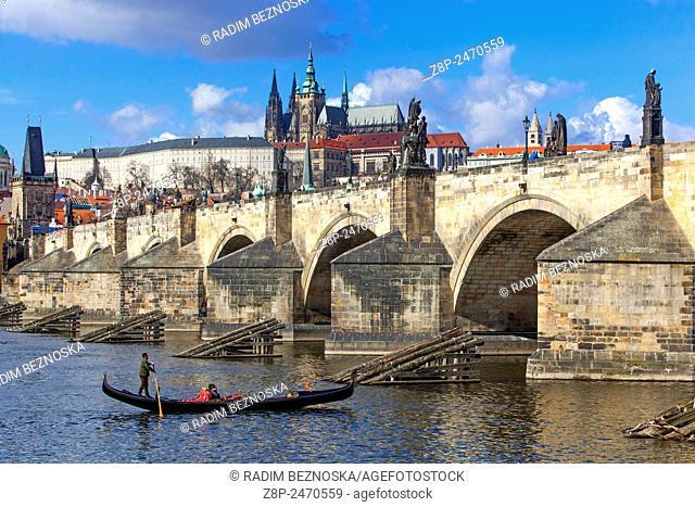Venetian gondola on the river Vltava under Charles Bridge, Prague, Czech Republic