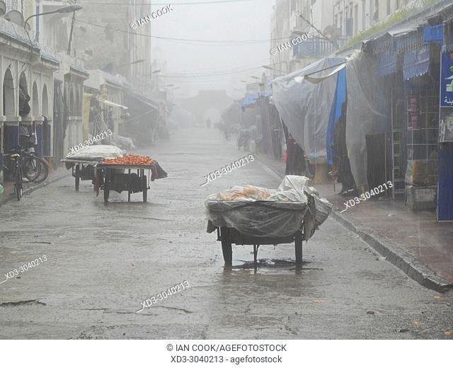 vendorâ. . s stall in heavy rain, Medina, Essaouira, Morocco
