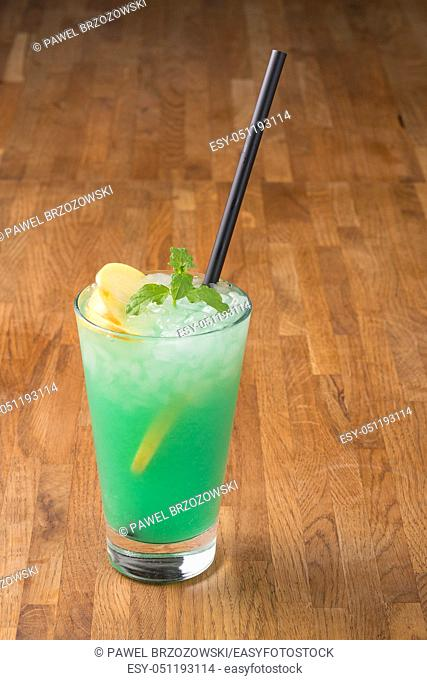 Green drink on wooden background. For fast food restaurant design or fast food menu