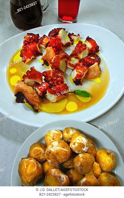 Specialities from Tenerife: Malvasia wine, octopus and 'papas arrugadas' (traditional baked potatoes). Canary Islands, Spain