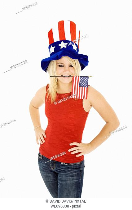 Beautiful Caucasian woman celibrating the 4th of July