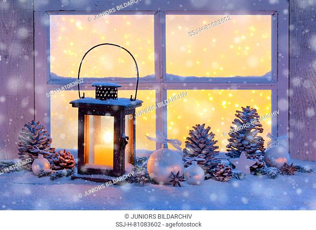 Lantern with Christmas decoration on windowsill. Switzerland
