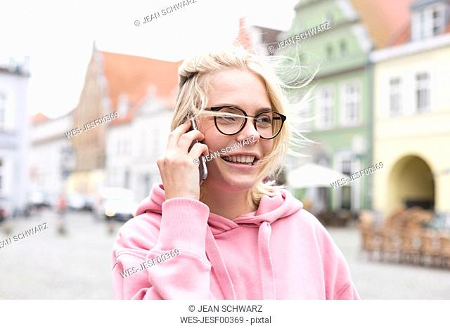 Portrait of blond woman using smartphone