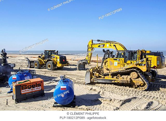 Sand replenishment / beach nourishment by Dredging International / DEME with bulldozers to reduce storm damage to coastal structures in Belgium