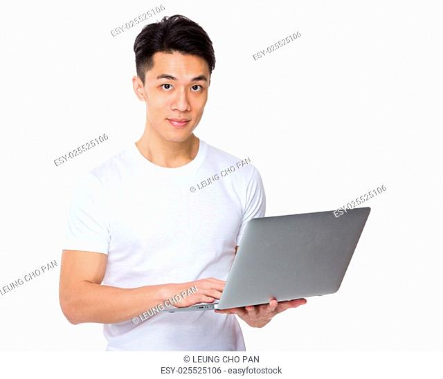 Young man use of the laptop computer