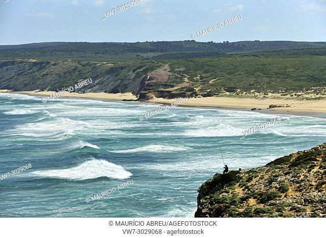 A fisherman in the coastline of Carrapateira. Sudoeste Alentejano and Costa Vicentina Nature Park, the wildest atlantic coast in Europe. Portugal