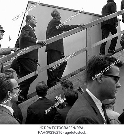 US president John F. Kennedy at a view point at the Berlin wall on 26 June 1963 followed by german chancellor Konrad Adenauer (M) and mayor Willy Brandt