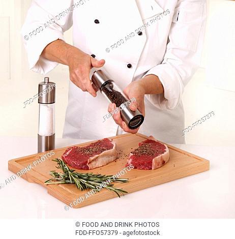 Chef seasoning beef steak