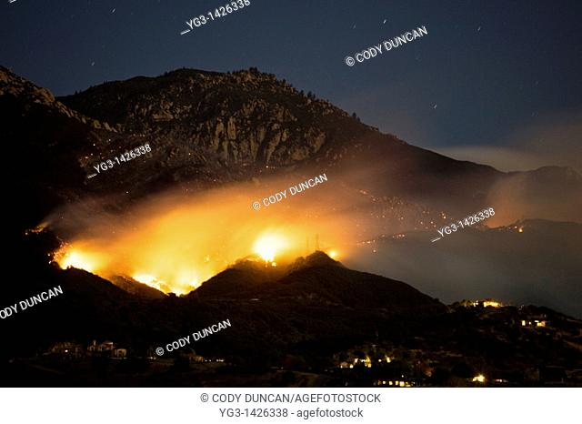 Santa Barbara, California - Out of control Jesusita fire burns the foothills above Santa Barbara on it's first night  Tuesday May 5, 2009