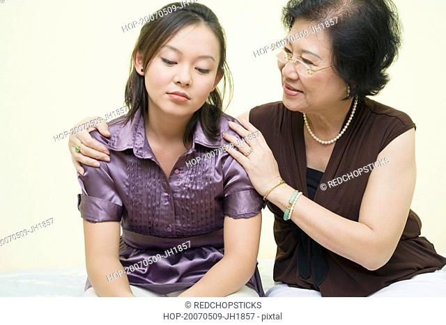 Close-up of a senior woman consoling her daughter