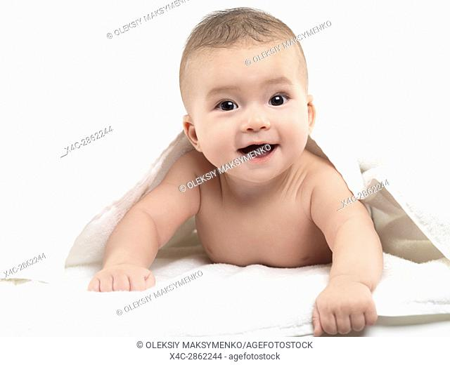 Portrait of a very cute little baby boy smiling face with a joyous excited expression looking at the camera. Four month old child