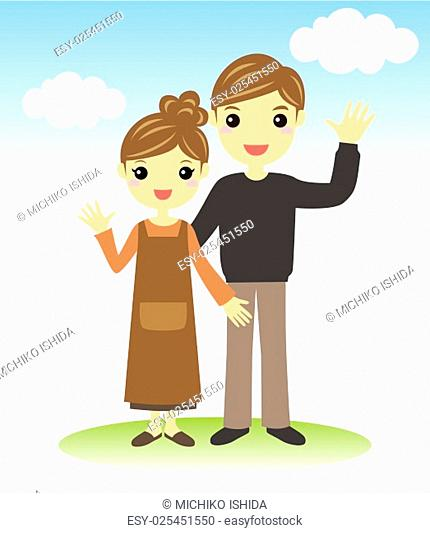 A young couple standing together outdoor on the lawn