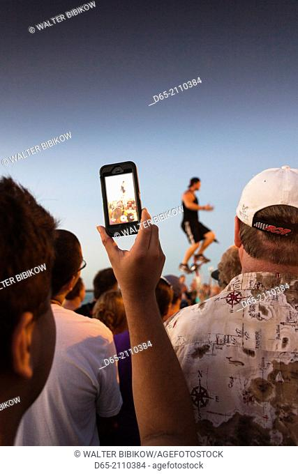 USA, Florida, Florida Keys, Key West, Mallory Square, daily sunset party, photographing the juggler, NR