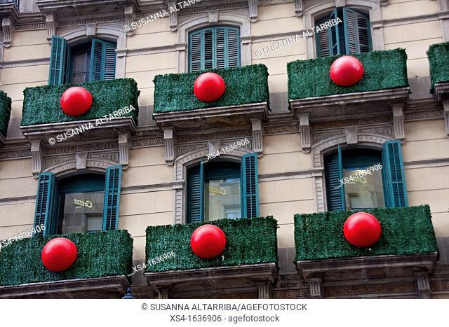 Balconies decorated in Portal del Angel, Barcelona, Spain, Europe
