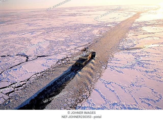 Ship sailing through ice