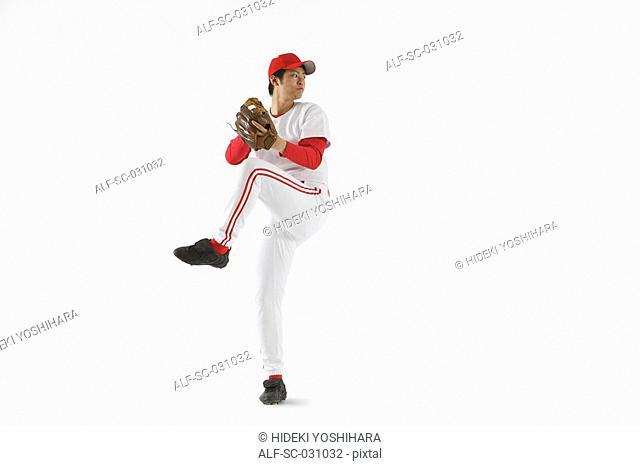 Pitcher Throwing Baseball