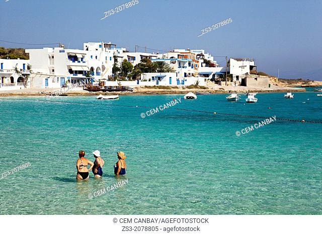 Elderly women in swimsuit taking their time in the sea, Koufonissi, Cyclades Islands, Greek Islands, Greece, Europe