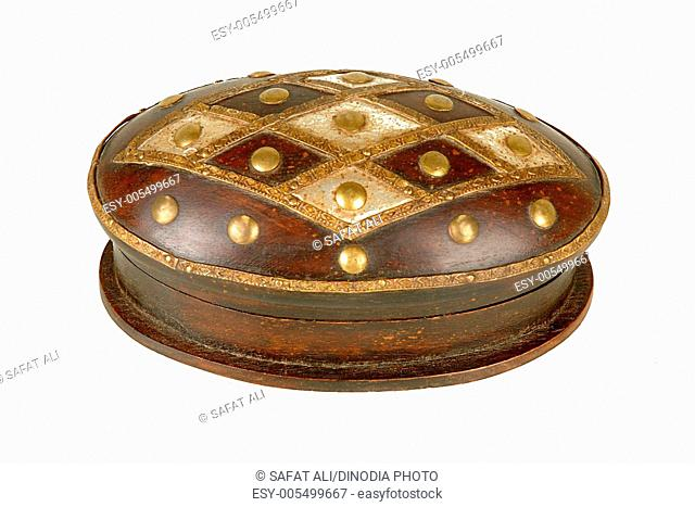 Brass design fitting on antique wooden round box ; Jodhpur ; Rajasthan ; India