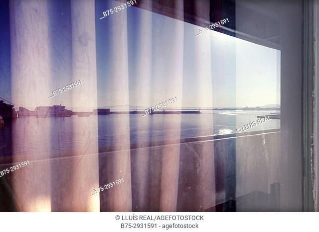 View of port from behind a ship's window. Mediterranean Coast, Palma, Majorca, Balearic Islands, Spain