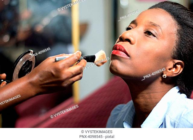 young woman is makeup in a beauty salon
