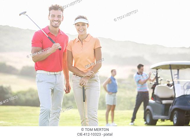 Smiling couple on golf course