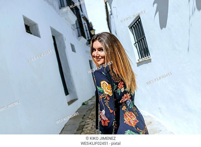 Spain, Cadiz, Vejer de la Frontera, portrait of fashionable woman wearing dress with floral design
