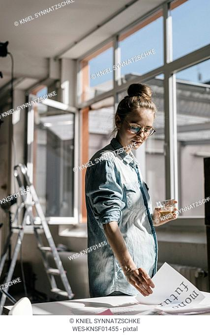 Young woman at table working on script templates